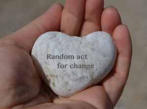 heart shaped rock with inscription random act for change